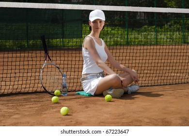Girl has a rest after tenis