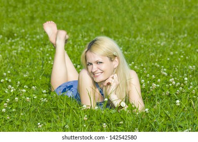 The girl has a rest lying on a grass