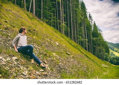 The girl has a rest in mountains