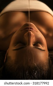 The girl has Shirodhara treatment - indian oil massage.