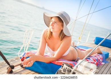Girl in a hat on the yacht. Lady on the yacht.