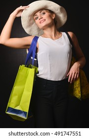 girl in a hat with shopping bags