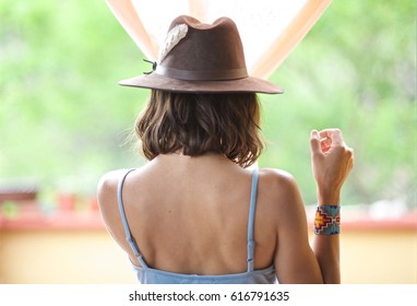 Girl with a hat walking