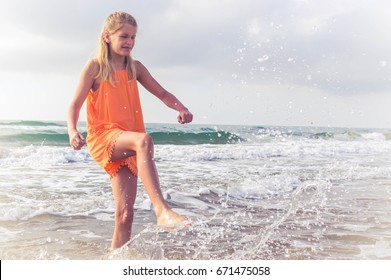 Girl have fun with clear sea water