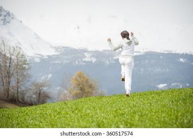 Girl having beautiful spring vacation in idyllic Alps