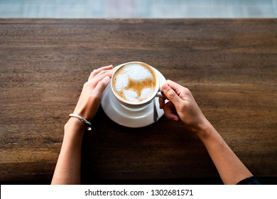 Girl having a cup of coffee in the bar po view