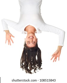 Girl having fun hanging upside down
