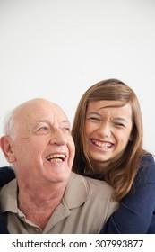 girl having fun with her grandfather