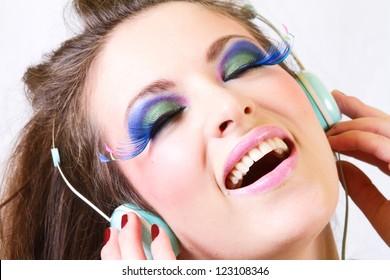 Girl Having Fun Listening to Music on Headphones