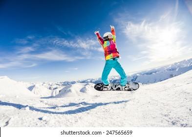 Girl having fun on her snowboard jumping
