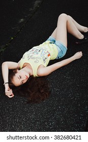 Girl having fun outdoor. Pretty girl sitting at school stadium. Rest from study. Outdoors, Lifestyle