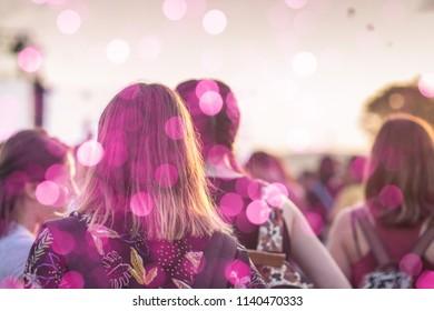 Girl having fun at summer festival concert