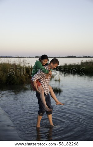 Girl is having a piggy back ride from her boyfriend.