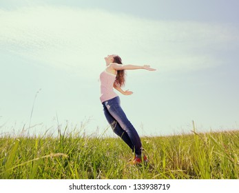 The girl, having stretched hands, enjoys a sunlight