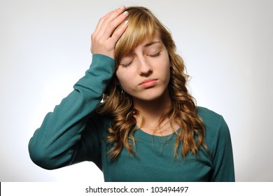 Girl With a Headache. Teenage girl with her hand on her head as if she has a headache. Note: not isolated.