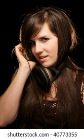 Girl in headphones enjoying music