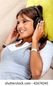 Girl with headphones listening to music indoors