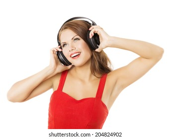 Girl in headphones listening to music. Woman portrait over white background