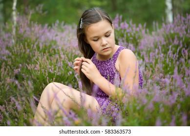 Girl in heather flowers, outdoor shoot