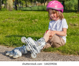 Girl with helmet on but without protective knee pads crying