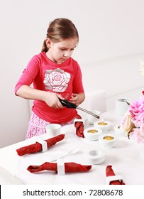 Girl helps to set the table