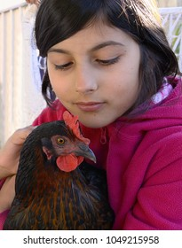 Girl and her chicken pet