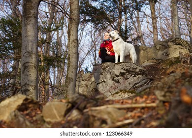Girl with her dog in forest