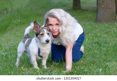 girl with her dog on the grass