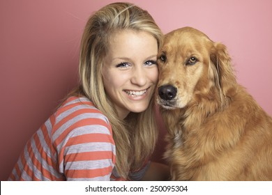 Girl and her dog together on a bedroom