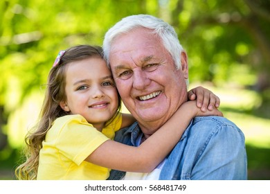 Girl with her grandfather in the park
