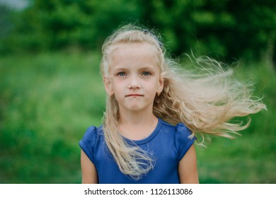Girl with her hair in the wind