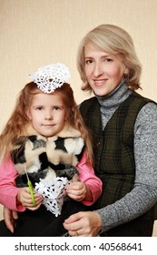 Girl with her mother cut Christmas snowflake