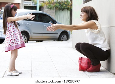 girl with her mother in the street