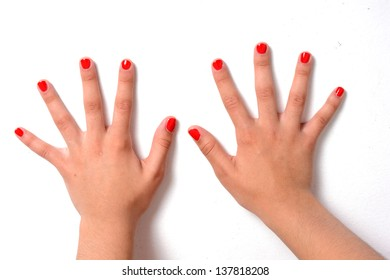 Girl with her nails painted a red color with a clear coat