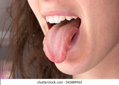 Girl with her tongue out
