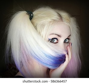Girl hides her face behind hair. Beautiful girl with dyed hair.