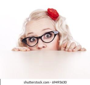 Girl hiding behind a desk