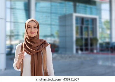 girl in hijab on the background of the business center