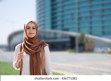 girl in a hijab on city background