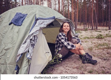 girl hiker in a tent mountains in the background