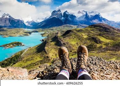 Girl hiking boots having fun and enjoying wonderful breathtaking mountain view. Freedom concept. Los Cuernos rocks, Patagonia, Chile