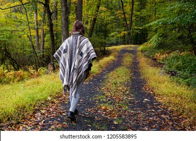 Girl hiking at fall inside the forest