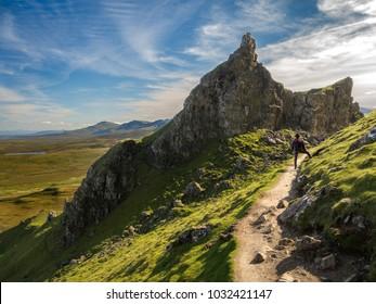 Girl hiking in the Quiraing, Quiraing, Isle of Skye, Scotland, Great Britain, Europe