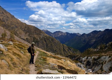A girl is hiking and watching a beautiful mountain landscape
