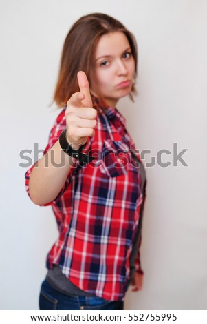 5f12738c908 Girl hipster in the red plaid shirt on white background gesture right at  you