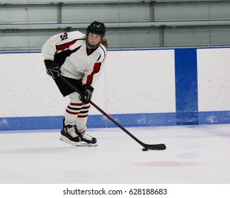 girl hockey player with puck