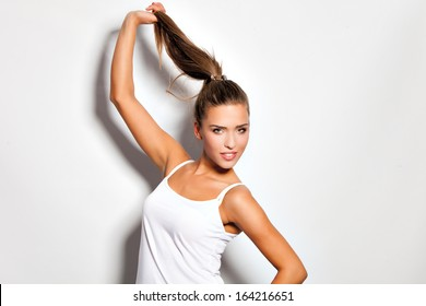 girl hold her long hair in ponytail