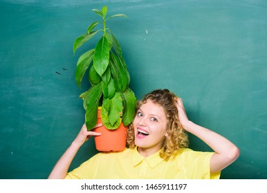 Girl hold plant in pot. Floral shop. Botany is about plants flowers and herbs. Home garden. Houseplants benefits and positive influence on health. Easy houseplants. Take good care houseplants.