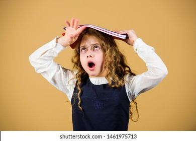 Girl hold textbook folder test. Preparing to exams in library. Small child formal wear. Prepare for exam. Formal education and homeschooling. Check knowledge. School exam concept. Final exam coming.