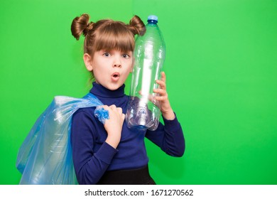 Girl hold trash bag and plastic bottle and shows interest in environmental issues isolated on green background. Child accustomed to bear responsibility for garbage since childhood. Plastic trash